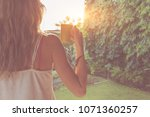 cute girl enjoying morning... | Shutterstock . vector #1071360257