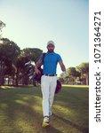 handsome middle eastern golf... | Shutterstock . vector #1071364271