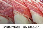 close up of raw meat slice | Shutterstock . vector #1071366614