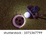 close up of putter hitting golf ... | Shutterstock . vector #1071367799