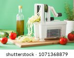 spiralizing courgette raw... | Shutterstock . vector #1071368879