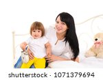 young smiling woman with long... | Shutterstock . vector #1071379694