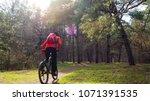 cyclist riding the mountain... | Shutterstock . vector #1071391535