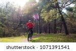 cyclist riding the mountain... | Shutterstock . vector #1071391541