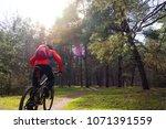 cyclist riding the mountain... | Shutterstock . vector #1071391559