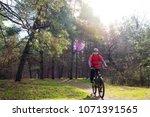 cyclist riding the mountain... | Shutterstock . vector #1071391565