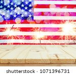 wooden table on usa flag with... | Shutterstock . vector #1071396731