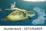 plastic pollution in ocean... | Shutterstock . vector #1071406805