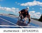 solar panel technician with... | Shutterstock . vector #1071423911