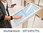 a woman with phone touching the ... | Shutterstock . vector #1071451751