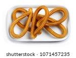 traditional spanish churros on... | Shutterstock . vector #1071457235