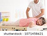 rehabilitation of a smiling... | Shutterstock . vector #1071458621