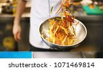 unrecognizable chef cooking... | Shutterstock . vector #1071469814
