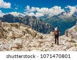 female trekker walking along... | Shutterstock . vector #1071470801