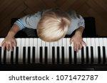 little boy's hands on keyboard  ... | Shutterstock . vector #1071472787