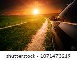 car on a dirt road in a field... | Shutterstock . vector #1071473219