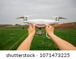 the white drone in hands at the ... | Shutterstock . vector #1071473225