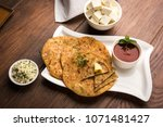 stuffed paneer paratha with... | Shutterstock . vector #1071481427