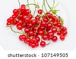 Berry red currant on white plate - stock photo