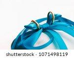 golden wedding rings on blue... | Shutterstock . vector #1071498119
