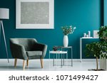 Green armchair against blue...