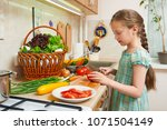 child girl cooking in home...   Shutterstock . vector #1071504149