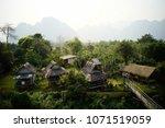 green village in vangvieng ... | Shutterstock . vector #1071519059
