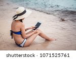 young woman using tablet... | Shutterstock . vector #1071525761
