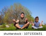 family doing yoga in park.   Shutterstock . vector #1071533651