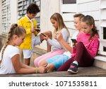 cheerful children are chatting... | Shutterstock . vector #1071535811