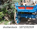 horse drawn carriage carrying... | Shutterstock . vector #1071552539