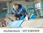 sheet metal folding. industrial ... | Shutterstock . vector #1071585509