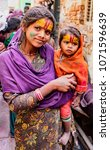 Small photo of Nandgeon, India, Holi Festival, Feb 25, 2018 - Mother and daughter show off their forehead painted symbols