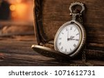 old pocket watch on the wooden... | Shutterstock . vector #1071612731