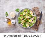 caesar salad with quail eggs ... | Shutterstock . vector #1071629294