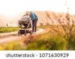 young mummy carries a baby... | Shutterstock . vector #1071630929