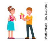 young man giving a woman... | Shutterstock .eps vector #1071630989