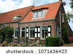 netherlands  typical dwelling... | Shutterstock . vector #1071636425