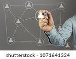 hand of a businessman holding a ...   Shutterstock . vector #1071641324
