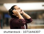 in a side shot young man... | Shutterstock . vector #1071646307
