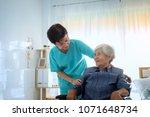 delighted positive caregiver... | Shutterstock . vector #1071648734