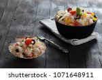 bowls with rice salad on black... | Shutterstock . vector #1071648911