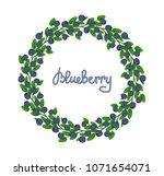 a wreath of blueberries.... | Shutterstock .eps vector #1071654071