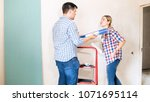 young woman shouting at husband ... | Shutterstock . vector #1071695114