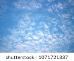 light blue sky with clouds... | Shutterstock . vector #1071721337