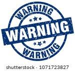 warning blue round grunge stamp | Shutterstock .eps vector #1071723827