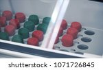 laboratory shaker loaded with... | Shutterstock . vector #1071726845