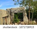 the stone arch in ruined roman... | Shutterstock . vector #1071728915