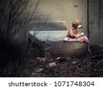 a toy bear on an old discarded...   Shutterstock . vector #1071748304
