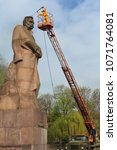 Small photo of LVIV, UKRAINE - April 16, 2018: Cleaning expert clean the monument to Ivan Franko. Maintenance man washing statue